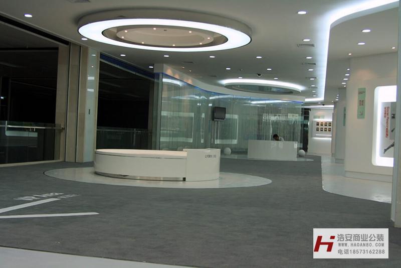 长沙办公室与商业空间装修公司浩安公装企业展厅装修设计案例效果图骏通达通信|集团展厅装修设计效果